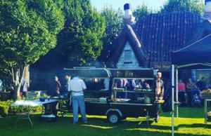 A customer catering for large outdoor event on Trailblazer BBQ.