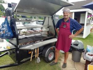 A customer posing beside his new Trailblazer BBQ
